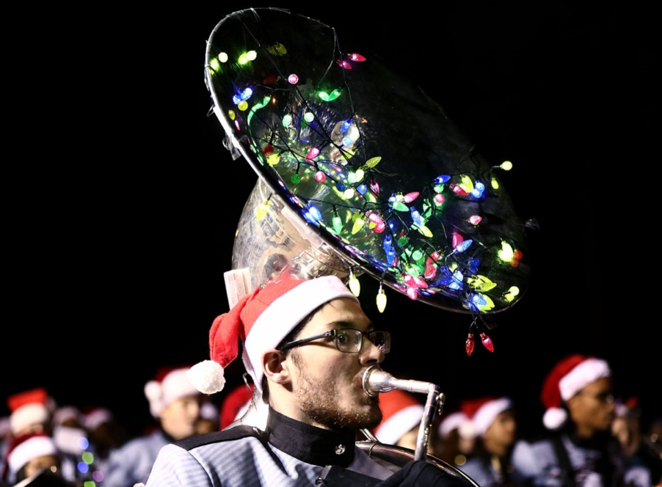 <strong>Members of the Collierville High School Band, decked in holiday apparel, marched in Collierville's 43rd annual Christmas Parade Dec. 6.</strong> (Patrick Lantrip/Daily Memphian)