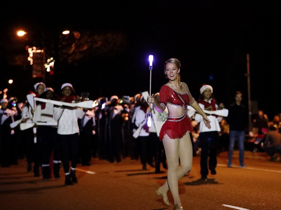 <strong>A majorette leads the the 43rd annual Collierville Christmas Parade Dec. 6 with a 21st century twist, an LED baton.</strong> (Patrick Lantrip/Daily Memphian)