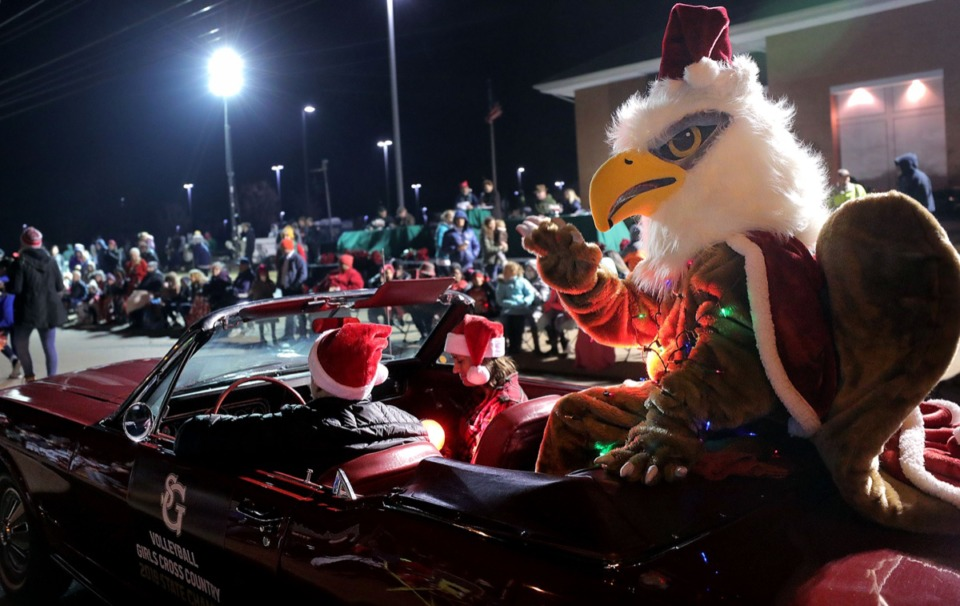 <strong>The St. George's Griffin waves to the crowd while covered in Christmas lights during the 43rd annual Collierville Christmas Parade Dec. 6.</strong> (Patrick Lantrip/Daily Memphian)