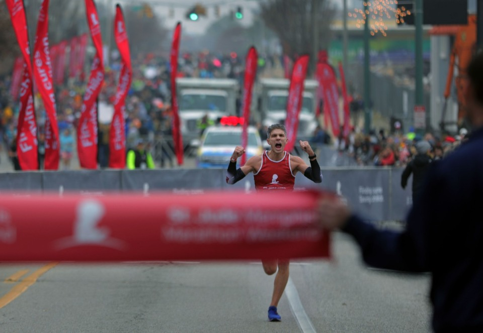 <strong>Adam Higham celebrates as he makes his way down the stretch on his way to a first-place finish at the St. Jude Marathon in Downtown Memphis on Dec. 7, 2019.</strong> (Patrick Lantrip/Daily Memphian)