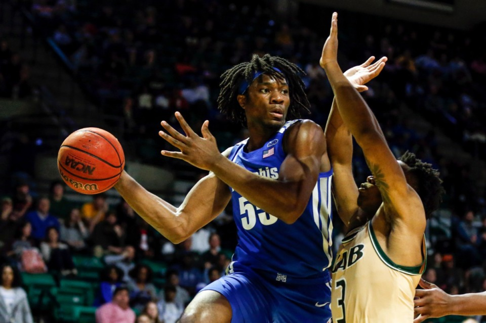 <strong>Memphis forward Precious Achiuwa (55) throws a pass as UAB guard Tavin Lovan (3) defends during the second half of an NCAA college basketball game Saturday, Dec. 7, 2019, in Birmingham, Ala.</strong> (Butch Dill/AP)