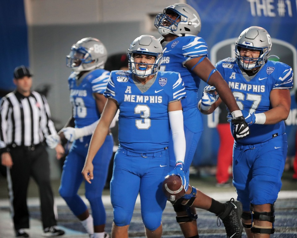 <strong>University of Memphis quarterback Brady White (3) celebrates after scorig a keeper touchdown against Cincinnati in the second half of the Tiger's AAC Championship game on Dec. 7, 2019, against the Bearcats at the Liberty Bowl Memorial Stadium.</strong> (Jim Weber/Daily Memphian)