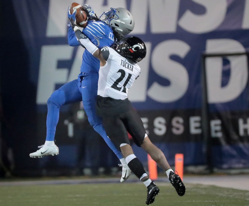 <strong>University of Memphis defensive back Chris Claybrooks picks of a pass intended for Cincinnati's Tre Tucker during the second half of the Tiger's AAC Championship game on Dec. 7, 2019, against the Bearcats at the Liberty Bowl Memorial Stadium.</strong> (Jim Weber/Daily Memphian)
