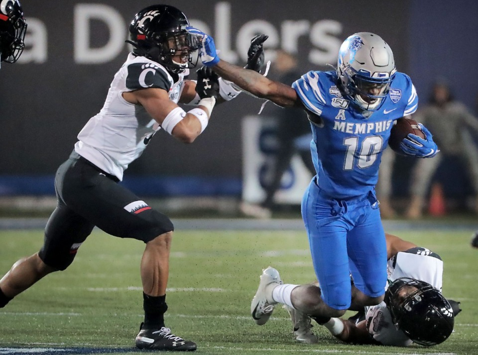 <strong>University of Memphis Damonte Coxie (10) is taken down during a run in the second half of the Tiger's AAC Championship game on Dec. 7, 2019, against the Bearcats at the Liberty Bowl Memorial Stadium.</strong> (Jim Weber/Daily Memphian)