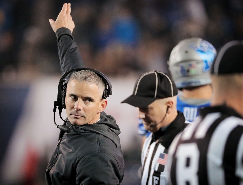 <strong>University of Memphis head coach Mike Norvell (left) reacts to a call on the field during the second half of the Tiger's AAC Championship game on Dec. 7, 2019, against the Bearcats at the Liberty Bowl Memorial Stadium.</strong> (Jim Weber/Daily Memphian)