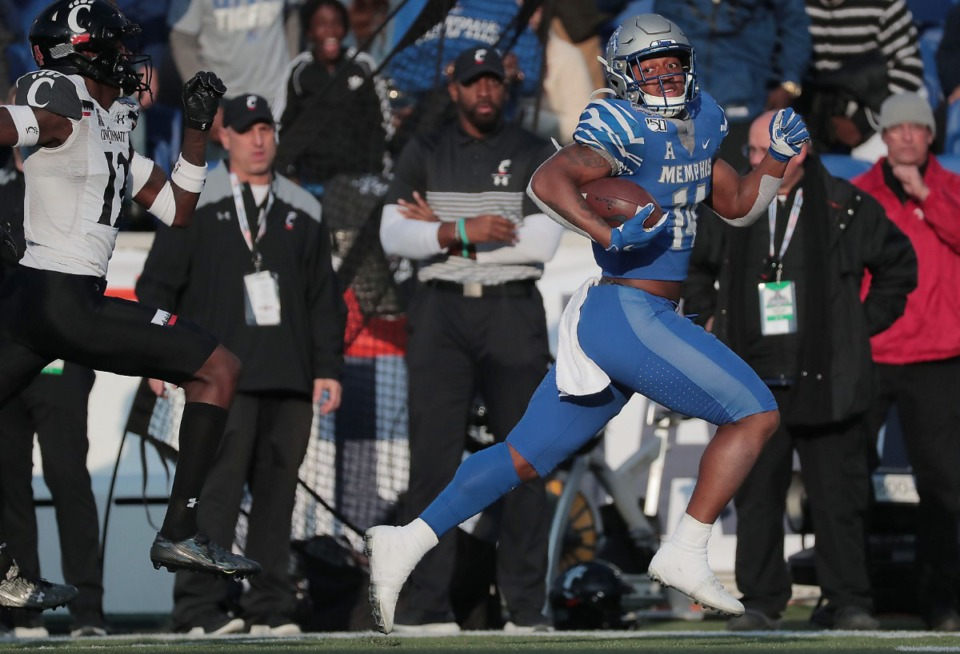 <strong>University of Memphis receiver Antonio Gibson (14) breaks away for a touchdown against Cincinnati's during the first half of the Tiger's AAC Championship game on Dec. 7, 2019, against the Bearcats at the Liberty Bowl Memorial Stadium.</strong> (Jim Weber/Daily Memphian)