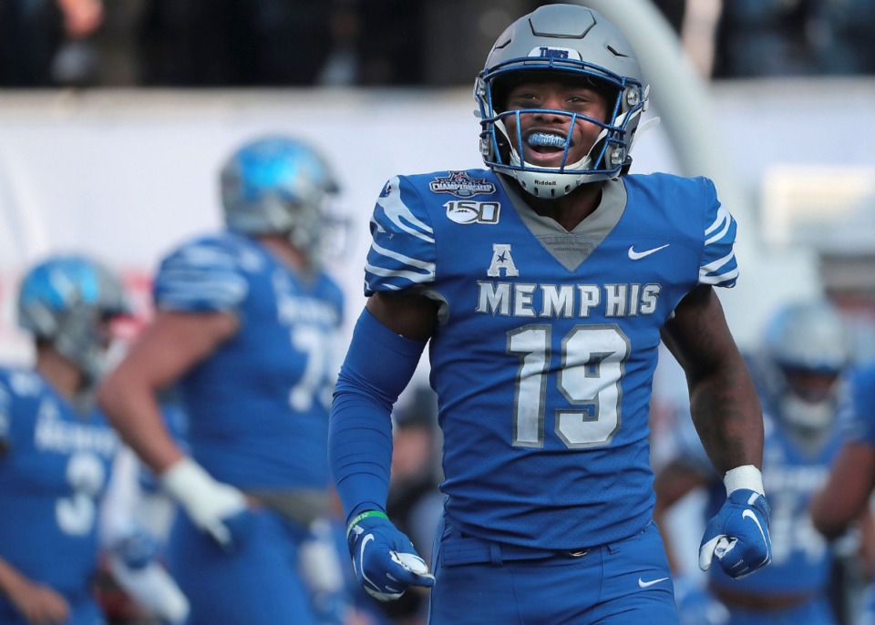 <strong>University of Memphis running back Kenneth Gainwell (19) reacts after a touchdown run by Antonio Gibson during the first half of the Tiger's AAC Championship game on Dec. 7, 2019, against the Bearcats at the Liberty Bowl Memorial Stadium.</strong> (Jim Weber/Daily Memphian)