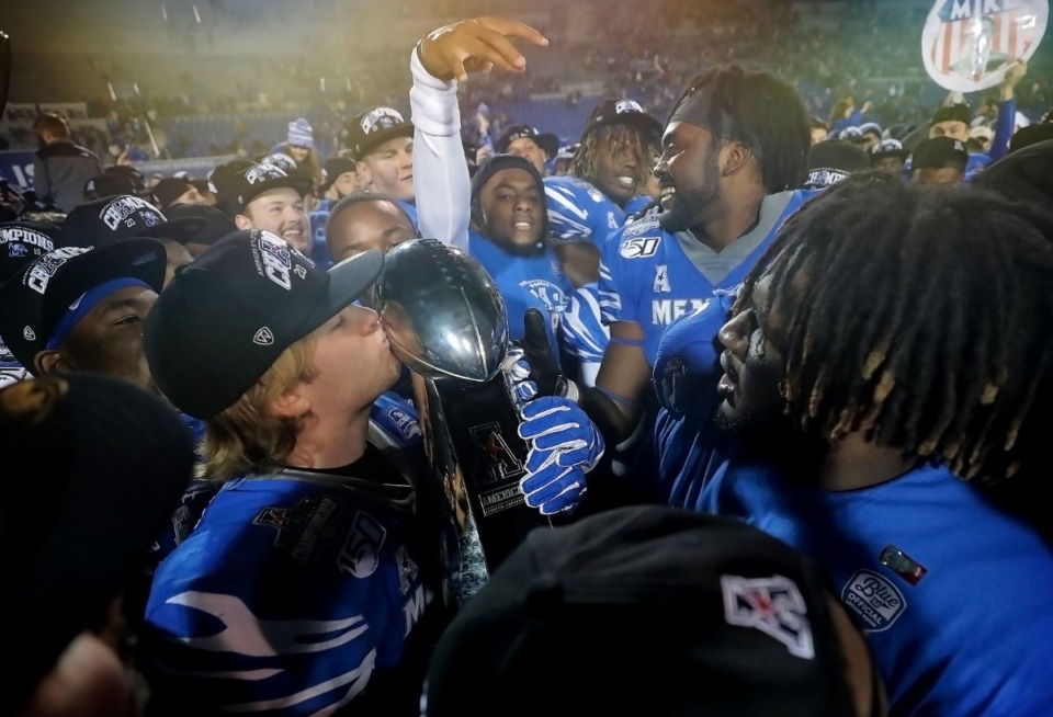 <strong>University of Memphis players celebrate after the Tiger's beat Cincinnati to win the AAC Championship game on Dec. 7, 2019, at the Liberty Bowl Memorial Stadium.</strong> (Jim Weber/Daily Memphian)