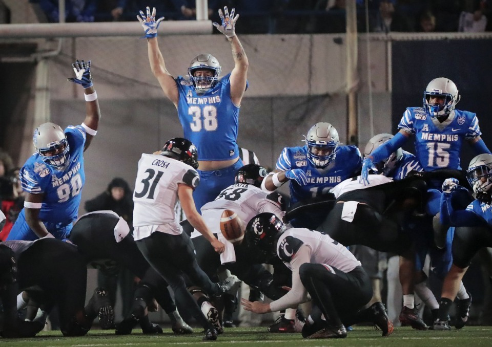 <strong>The University of Memphis defensive line puts pressure on Cincinnati's kicker Sam Crosa during the second half of the Tiger's AAC Championship game on Dec. 7, 2019, against the Bearcats at the Liberty Bowl Memorial Stadium.</strong> (Jim Weber/Daily Memphian)