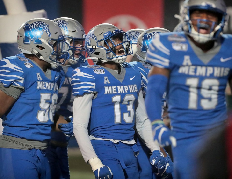 <strong>University of Memphis players celebrate after a touchdown in the second half of the Tiger's AAC Championship game on Dec. 7, 2019, against the Bearcats at the Liberty Bowl Memorial Stadium.</strong> (Jim Weber/Daily Memphian)