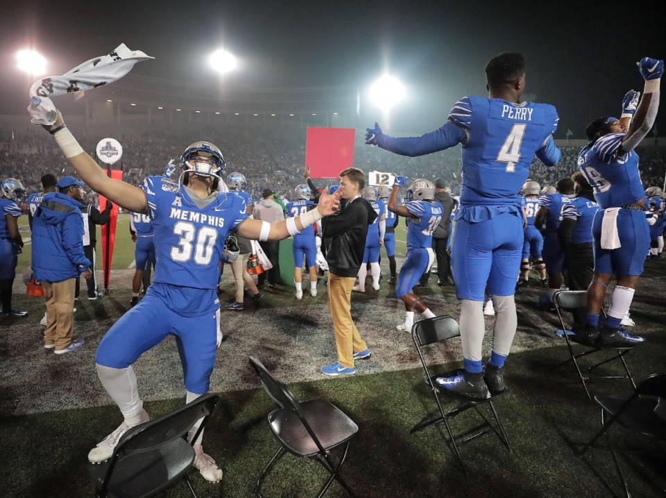 <strong>University of Memphis players celebrate in the final minutes of the Tiger's win over Cincinnati to for the AAC Championship title on Dec. 7, 2019, at the Liberty Bowl Memorial Stadium.</strong> (Jim Weber/Daily Memphian)