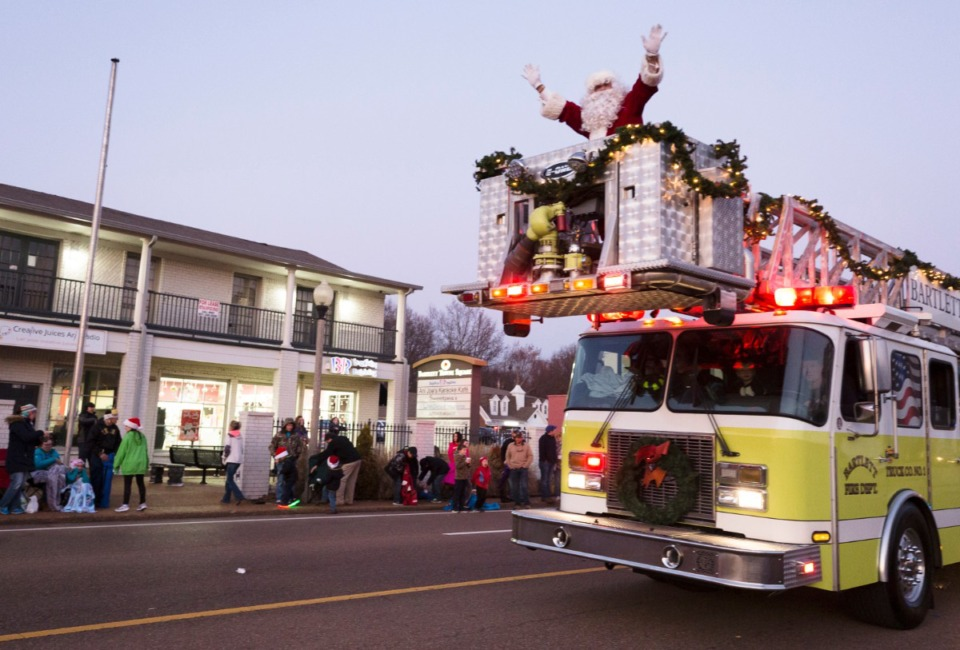 <strong>The Bartlett Fire Department gives Santa a lift to the the annual Bartlett Christmas Parade on December 7, 2019.</strong> (Ziggy Mack/special to the Daily Memphian)