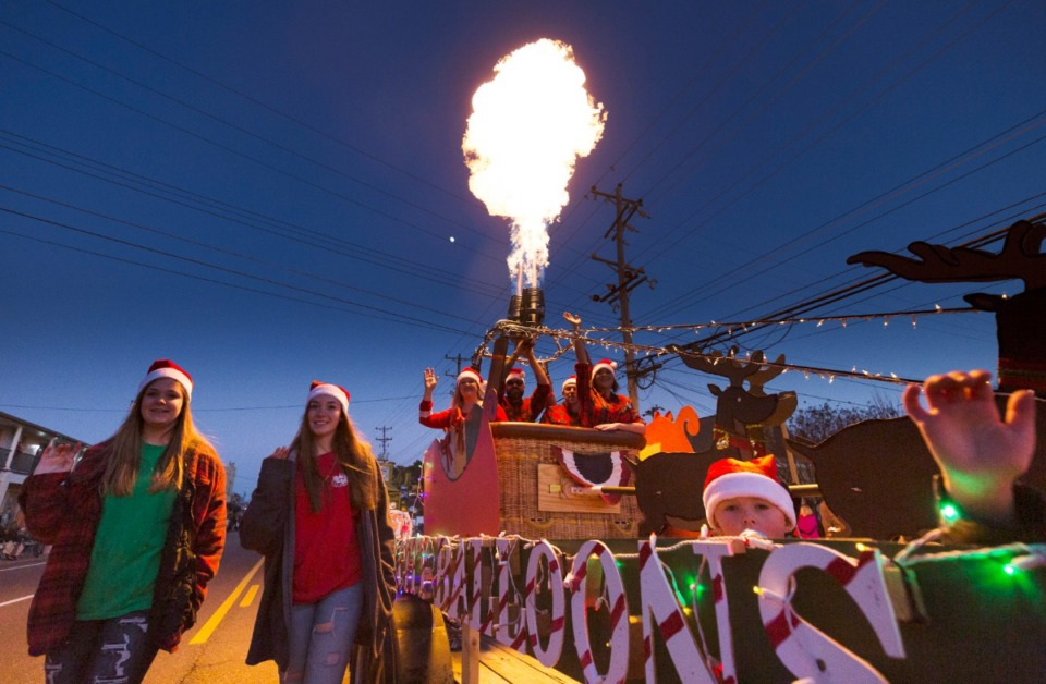 <strong>The Bluff City Balloons light up the night with a balloon torch during Bartlett Christmas Parade on December 7, 2019.</strong> (Ziggy Mack/special to the Daily Memphian)