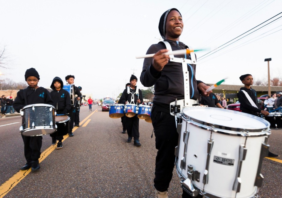 <strong>Jaqurius Burkins (right) of the Memphis Youth Arts Institution leads his drum corps during the Bartlett Christmas Parade on December 7, 2019.</strong> (Ziggy Mack/special to the Daily Memphian)