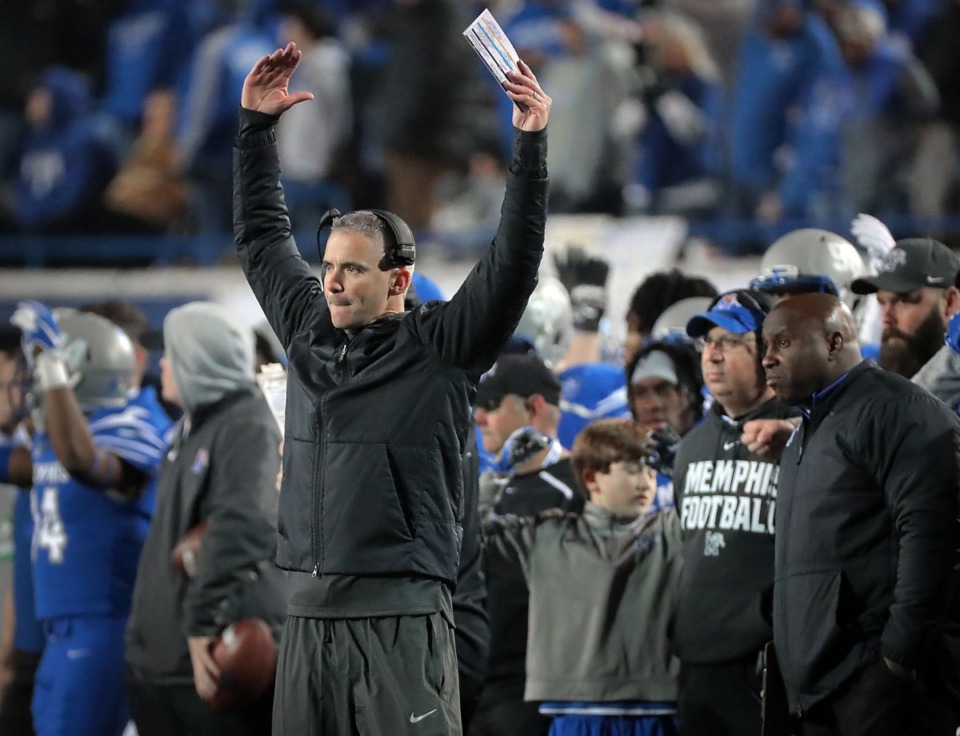 <strong>University of Memphis head coach Mike Norvell (hands up) reacts to a call on the field during the second half of the Tigers' AAC Championship win on Dec. 7. The hunt has begun for his successor.</strong> (Jim Weber/Daily Memphian)