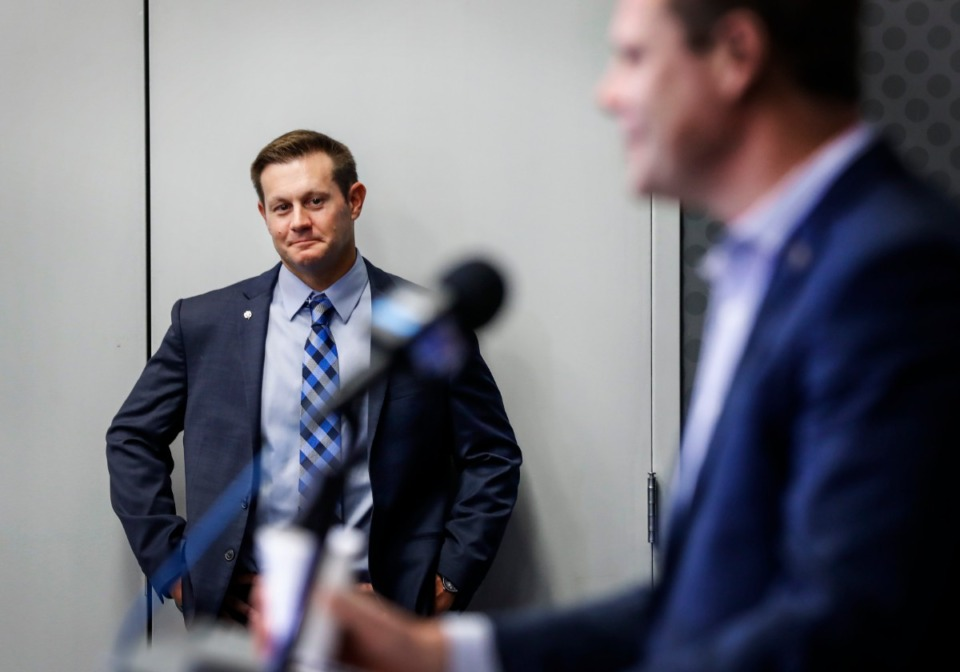 <strong>Memphis interim head coach Ryan Silverfield (left) listens to AD Laird Veatch Dec. 8 as he announcers Mike Norvell's imminent departure.</strong> (Mark Weber/Daily Memphian)