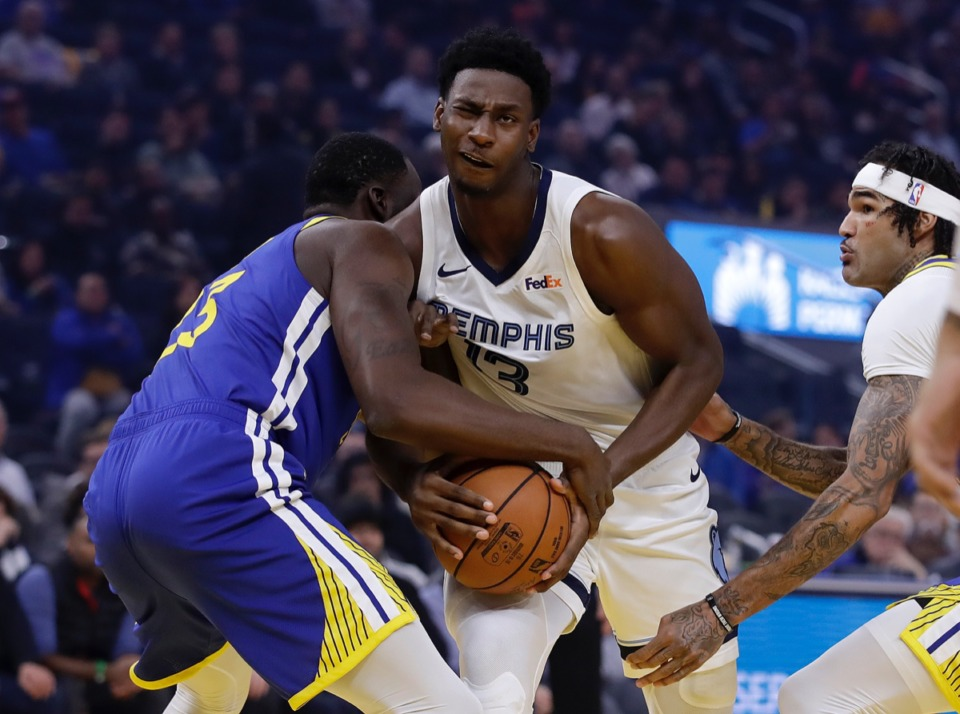 <strong>Memphis Grizzlies' Jaren Jackson Jr., center, keeps the ball from Golden State Warriors' Draymond Green Dec. 9 in San Francisco.</strong> (Ben Margot/AP)