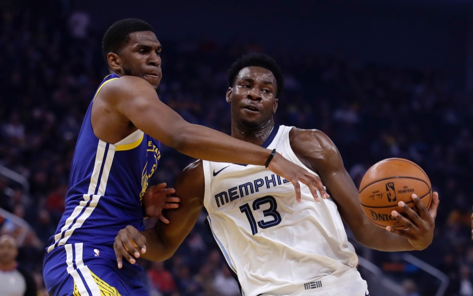 <strong>Memphis Grizzlies' Jaren Jackson Jr. (13) keeps the ball from Golden State Warriors' Kevon Looney, left, Dec. 9 in San Francisco.</strong> (Ben Margot/AP)