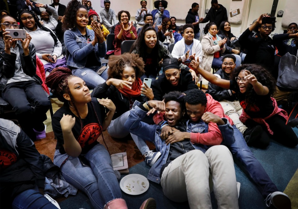 """<strong>Stax Music Academy students celebrate as they watch themselves perform on the """"Ellen's Greatest Night of Giveaways,"""" television show Dec. 12 during a watch party at Soulsville.</strong> (Mark Weber/Daily Memphian)"""