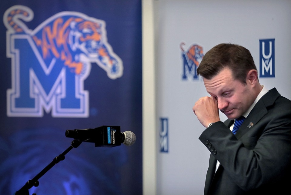 "<strong>The new University of Memphis head football coach Ryan Silverfield steps away from the lectern on Dec. 13 to wipe tears from his eyes during a press conference at the Billy Murphy Athletic Complex to announce that the former assistant coach has accepted his ""dream job.""</strong> (Jim Weber/Daily Memphian)"