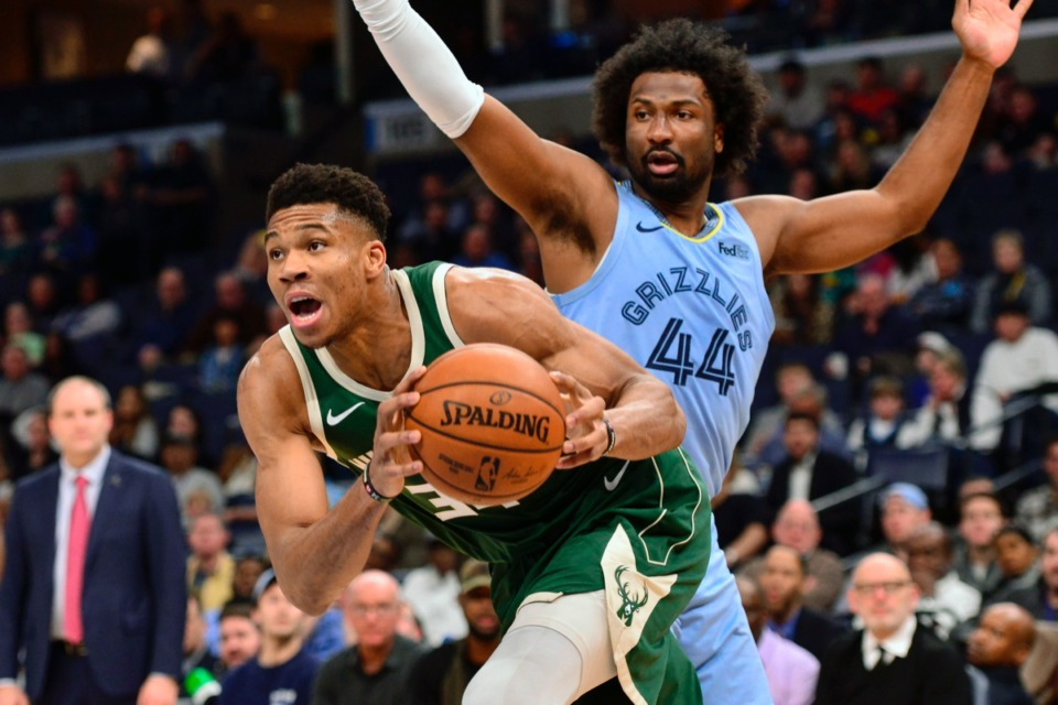 <strong>Milwaukee Bucks forward Giannis Antetokounmpo drives ahead of Memphis Grizzlies forward Solomon Hill (44) Dec. 13 at FedExForum.</strong> (Brandon Dill/AP)