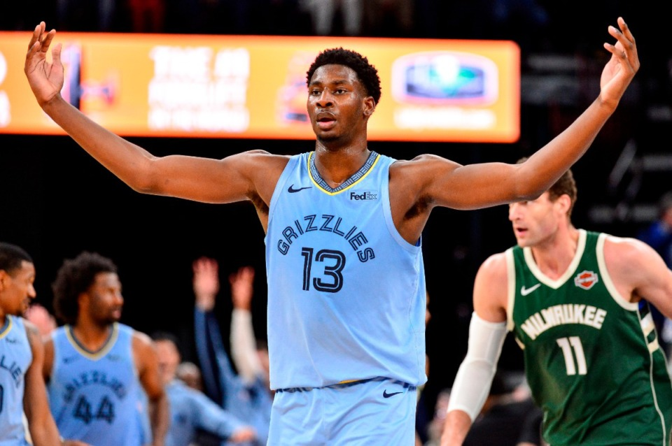 <strong>Grizzlies forward Jaren Jackson Jr. (13) gestures to the crowd after scoring a three-point basket in the Dec. 13 game against the Milwaukee Bucks at FedExForum.</strong> (Brandon Dill/AP)
