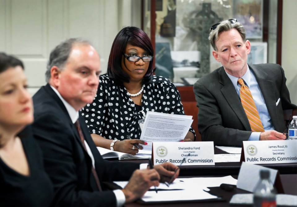 <strong>Shelby County Register of Deeds Shelandra Ford (middle) and County Historian, Jimmy Rout III (right) at a Public Records Commission Meeting Dec. 12, 2019. Ford has won the first round in her battle to get temporary funding to hire more employees of records management.</strong> (Mark Weber/Daily Memphian)