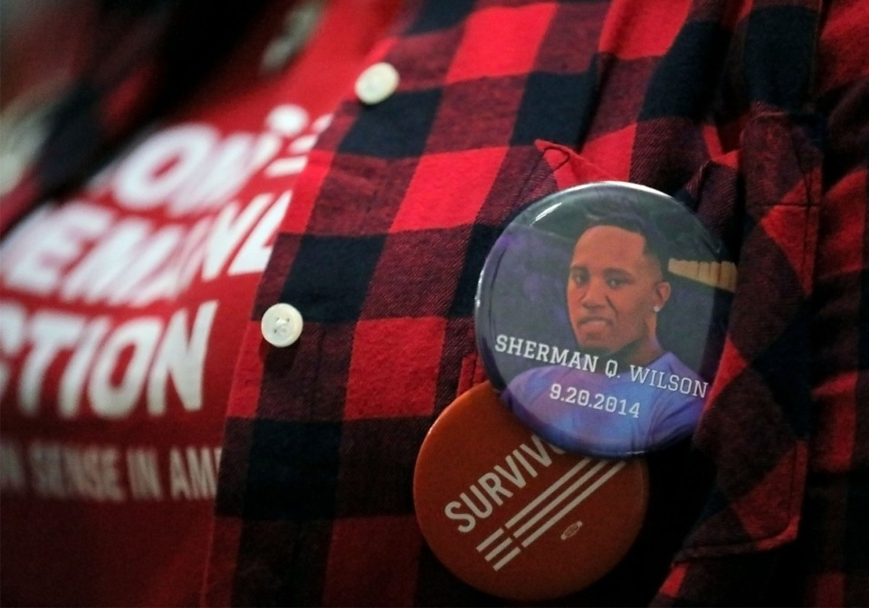 <strong>Marsha Wilson wears a button honoring her fallen son who died in 2014 while attending a night of remembrance for the Memphians who've lost their lives to gun violence this year at the Holy City Church of God in Christ Dec. 13, 2019.</strong> (Patrick Lantrip/Daily Memphian)