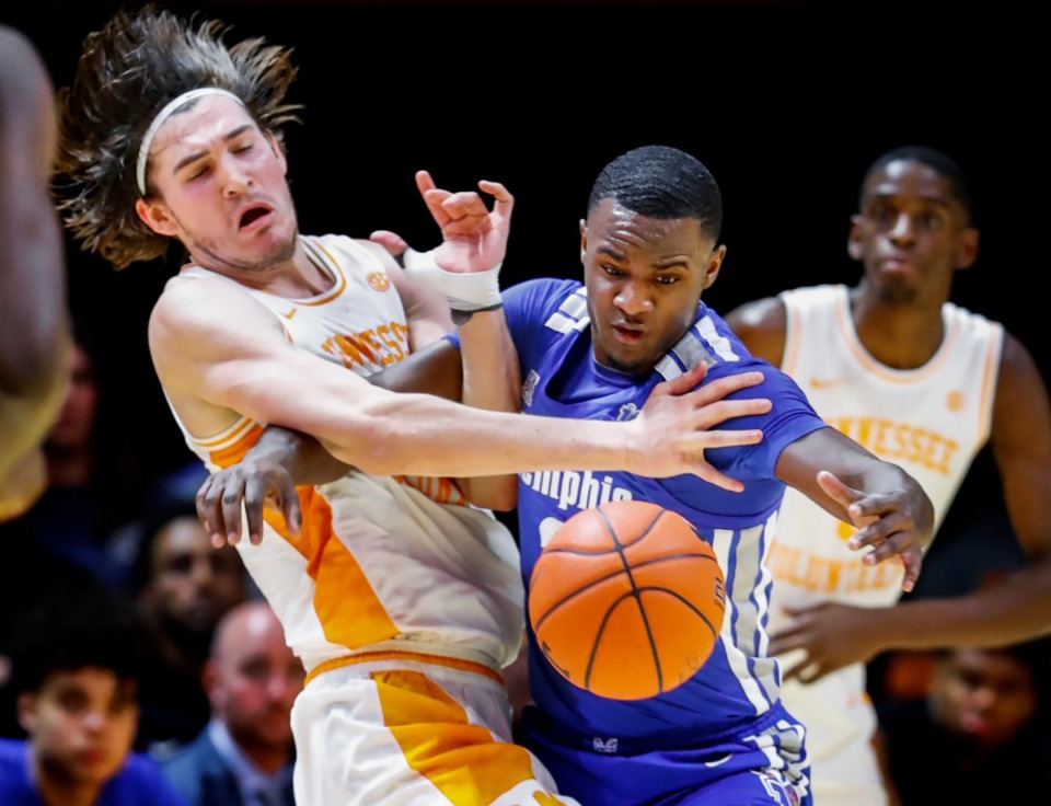 <strong>Memphis defender Alex Lomax (right) steals the ball away from Tennessee forward John Fulkerson (left) during action Saturday, Dec. 14, 2019 in Knoxville, Tennessee.</strong> (Mark Weber/Daily Memphian)