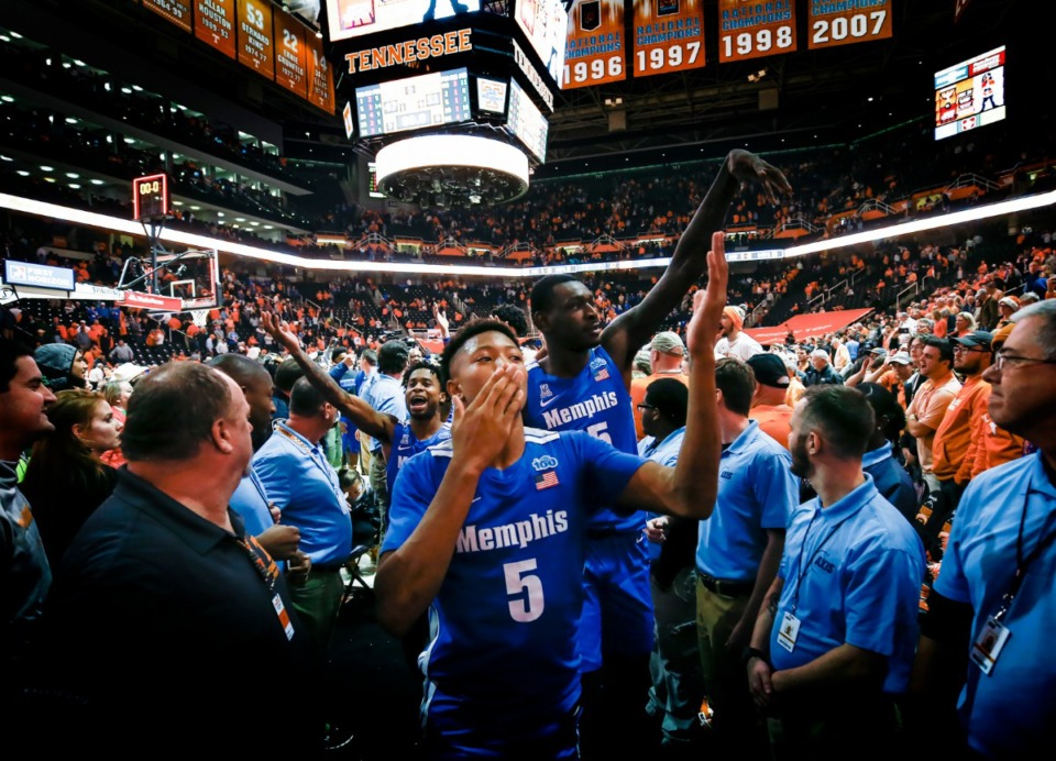 <strong>Memphis guard Boogie Ellis (middle) blows kisses to the Tennessee fans after the Tigers defeated the Vols 51-47 Saturday, Dec. 14, 2019 in Knoxville, Tennessee.</strong> (Mark Weber/Daily Memphian)