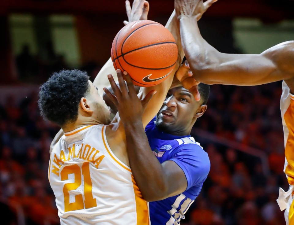 <strong>Memphis guard Alex Lomax (right) is fouled by Tennessee defender Olivier Nkamhoua (left) during action Saturday, Dec. 14, 2019 in Knoxville, Tennessee.</strong> (Mark Weber/Daily Memphian)