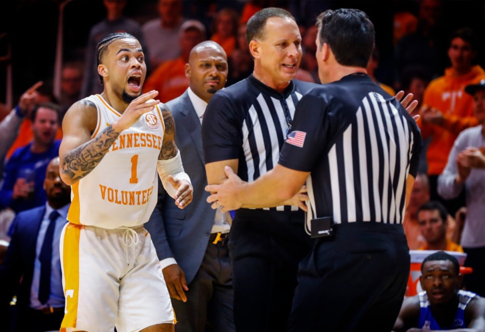 <strong>Tennessee guard Lamonte Turner (left) reacts while the officials confer on who knocked the ball out of bounds during action against Memphis Saturday, Dec. 14, 2019 in Knoxville, Tennessee.</strong> (Mark Weber/Daily Memphian)