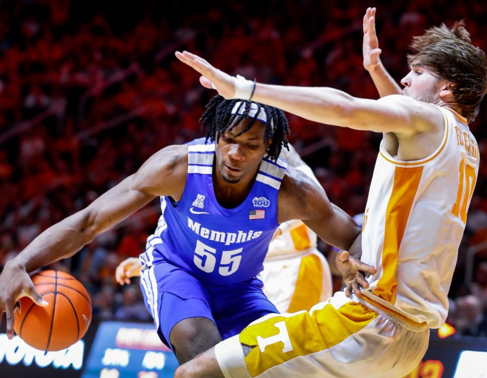 <strong>Memphis forward Precious Achiuwa (left) is called for a charging foul after running into Tennessee defender John Fulkerson (right) during action Saturday, Dec. 14, 2019 in Knoxville, Tennessee.</strong> (Mark Weber/Daily Memphian)