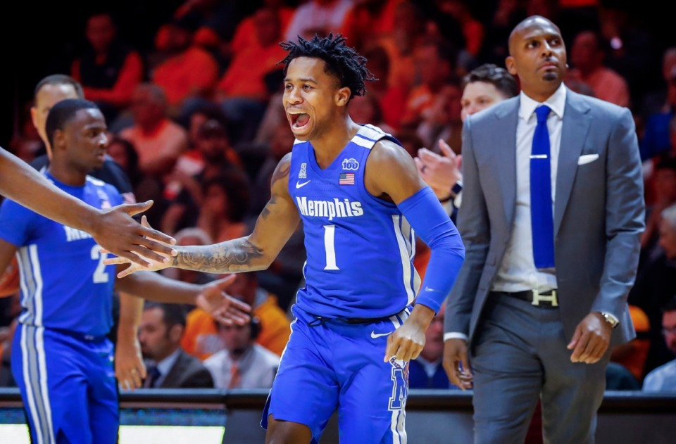 <strong>Memphis guard Tyler Harris (middle) celebrates during a timeout during action against Tennessee Saturday, Dec. 14, 2019 in Knoxville, Tennessee.</strong> (Mark Weber/Daily Memphian)