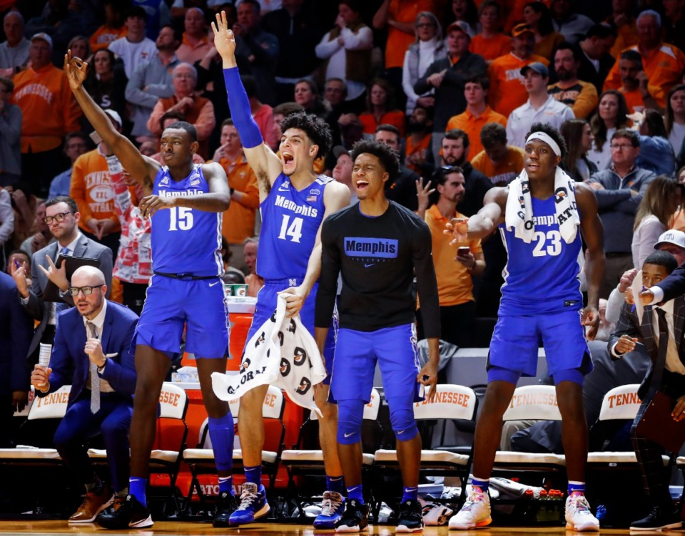<strong>Memphis teammates (left to right) Lance Thomas, Isaiah Maurice, Jayden Hardaway and Malcolm Dandridge celebrate a made 3-pointer against Tennessee during action Saturday, Dec. 14, 2019 in Knoxville, Tennessee.</strong> (Mark Weber/Daily Memphian)