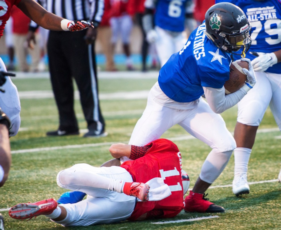 <strong>Blue team wide receiver Joshua Hastings from Cordova fights to get free from Red team's Dante Carrasco of St. Benedict at the Liberty Bowl High School All-Star game on Dec. 14, 2019, at MUS. Hastings scored in the fourth quarter.</strong> (Greg Campbell/Special to The Daily Memphian)
