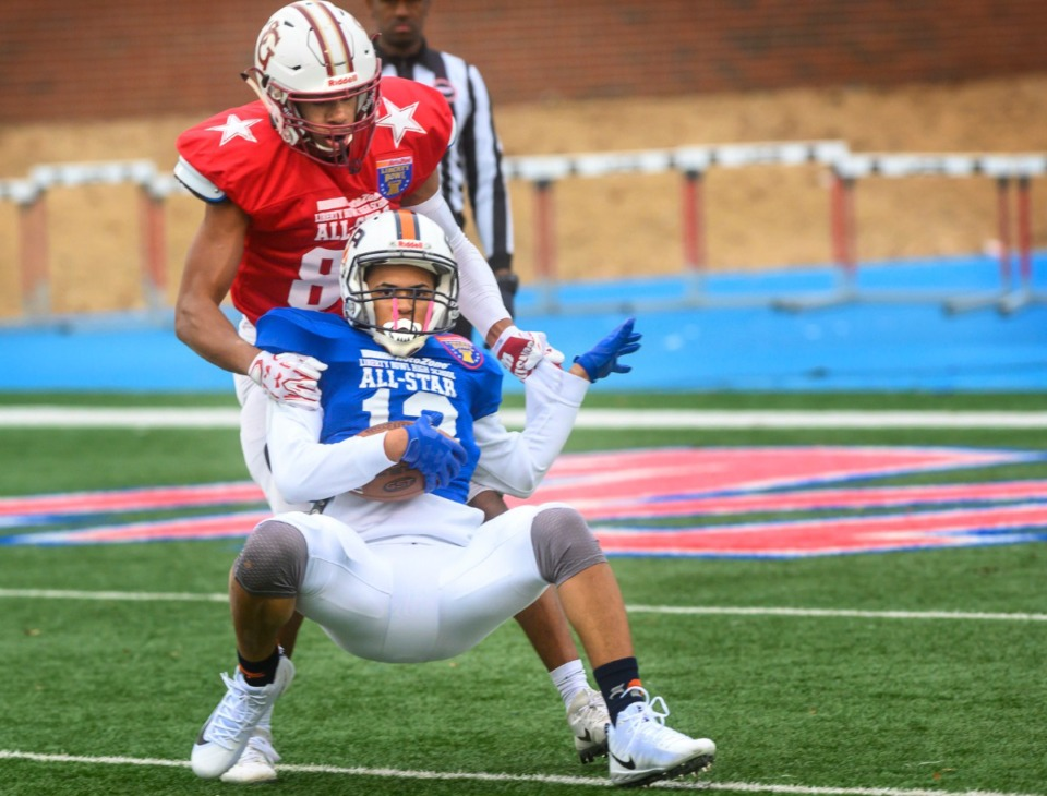 <strong>Blue team defensive back Anthony Walker from Freedom Prep intercepts the ball late in the second quarter as Red team wide receiver Isaac Smith from St. George's pulls him down at the Liberty Bowl High School All-Star game on Dec. 14, 2019, at MUS.&nbsp;</strong>(Greg Campbell/Special to The Daily Memphian)