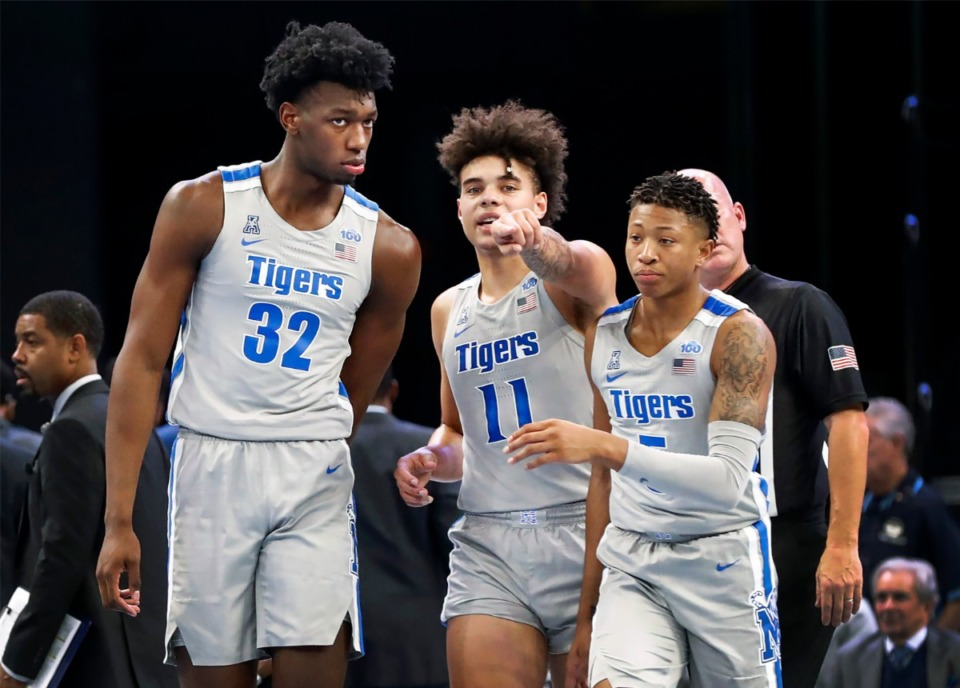 <strong>Memphis center James Wiseman (left) converses with teammates Lester Quinones (middle) and Boogie Ellis (right) during a break in action against UIC Friday, Nov. 8, 2019 at the FedExForum.</strong> (Mark Weber/Daily Memphian)