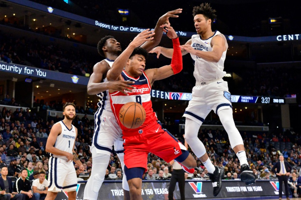 <strong>Washington Wizards forward Rui Hachimura (8) is fouled while shooting between Memphis Grizzlies forwards Jaren Jackson Jr. (left) and Brandon Clarke (15) in the first half of an NBA basketball game on Dec. 14, 2019, in Memphis.</strong> (AP Photo/Brandon Dill)