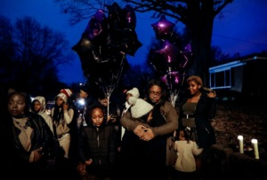 <strong>Family and friends of Demont'e Johnson, a 13-year-old killed on Dec. 8, attend a vigil on what would have been his 14th birthday on Dec. 10, 2019, in Orange Mound.</strong> (Mark Weber/Daily Memphian)