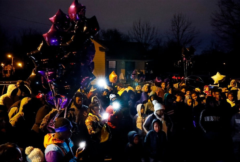<strong>Family and friends of Demont'e Johnson, a 13-year-old killed on Dec. 8, attend a vigil on what would have been his 14th birthday Dec. 10, 2019, in Orange Mound.</strong> (Mark Weber/Daily Memphian)
