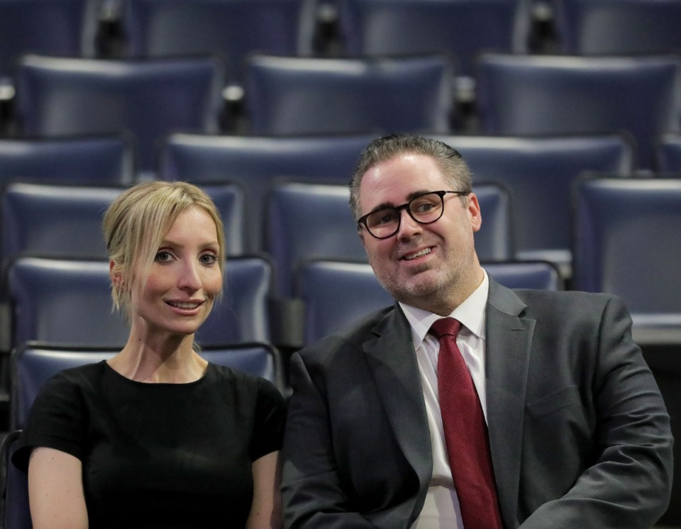 <strong>Chantal Hassard and John Pugliese sit together in the stands at FedExForum Dec. 13, 2019, as they did nine years ago. Hassard and Pugliese are the last Grizzlies employees remaining from the Vancouver Grizzlies era.</strong> (Patrick Lantrip/Daily Memphian)