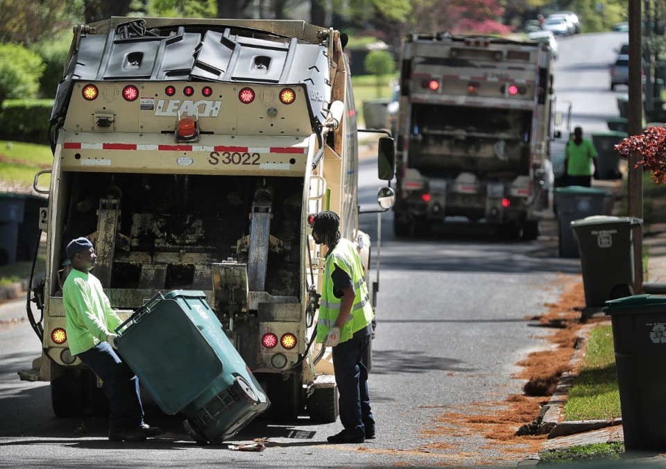 <strong>Memphis sanitation workers Roy Britt (left) and Mario Norman pick up garbage and some yard waste in the High Point Terrace area on April 10. The City Council may revisit the proposed fee hike on solid waste.</strong> (Jim Weber/Daily Memphian)