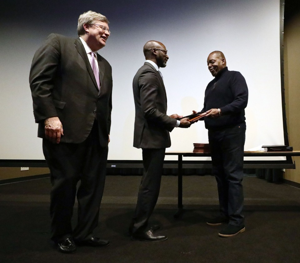 <strong>Chet Jackson (right) and Memphis Mayor Jim Strickland (left) hand out plaques and certificates during a graduation ceremony Dec. 16 for the inaugural class of the Memphis REDi program, which is aimed at developing more minority and women developers.</strong> (Patrick Lantrip/Daily Memphian)