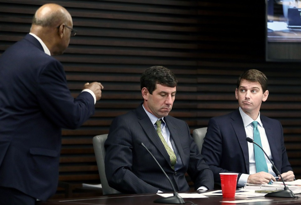 <strong>Outgoing Memphis City Council member Joe Brown (left) talks with fellow councilmembers Reid Hedgepeth (center) and Worth Morgan (right) during a Memphis City Council Executive session Dec. 17.</strong> (Patrick Lantrip/Daily Memphian)