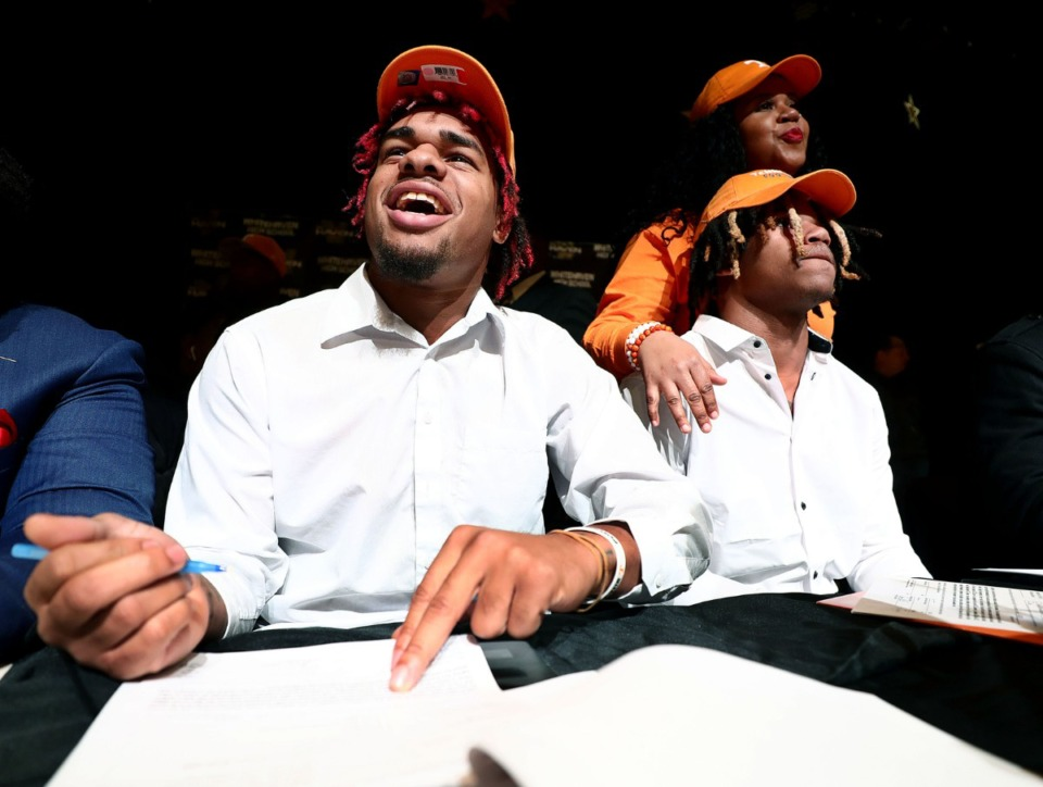 <strong>Whitehaven High School senior Martavius French signs his letter of intent to play football at the University of Tennessee next season during a signing day event held at Whitehaven High School Dec. 18, 2019.</strong>&nbsp;<strong>Tamarion McDonald, another Vol signee, sits alongside French.</strong> (Patrick Lantrip/Daily Memphian)