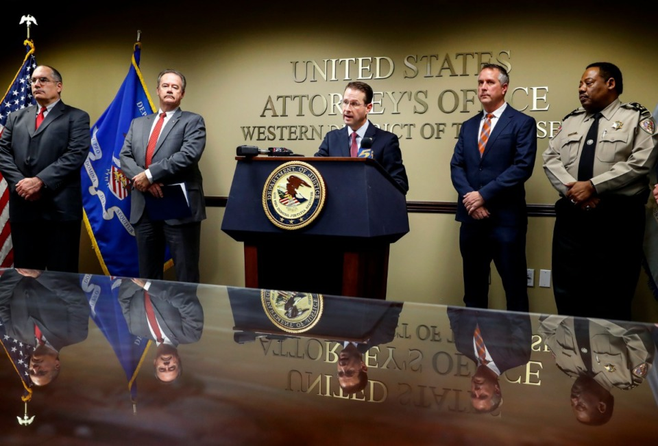 <strong>Michael Dunavant (center), the U.S. Attorney for the Western District of Tennessee, holds a press conference with federal and Memphis law enforcement to announce Operation Relentless Pursuit, Wednesday, Dec. 18, 2019. The initiative will pair federal law enforcement with local authorities to fight violent crime.</strong> (Mark Weber/Daily Memphian)