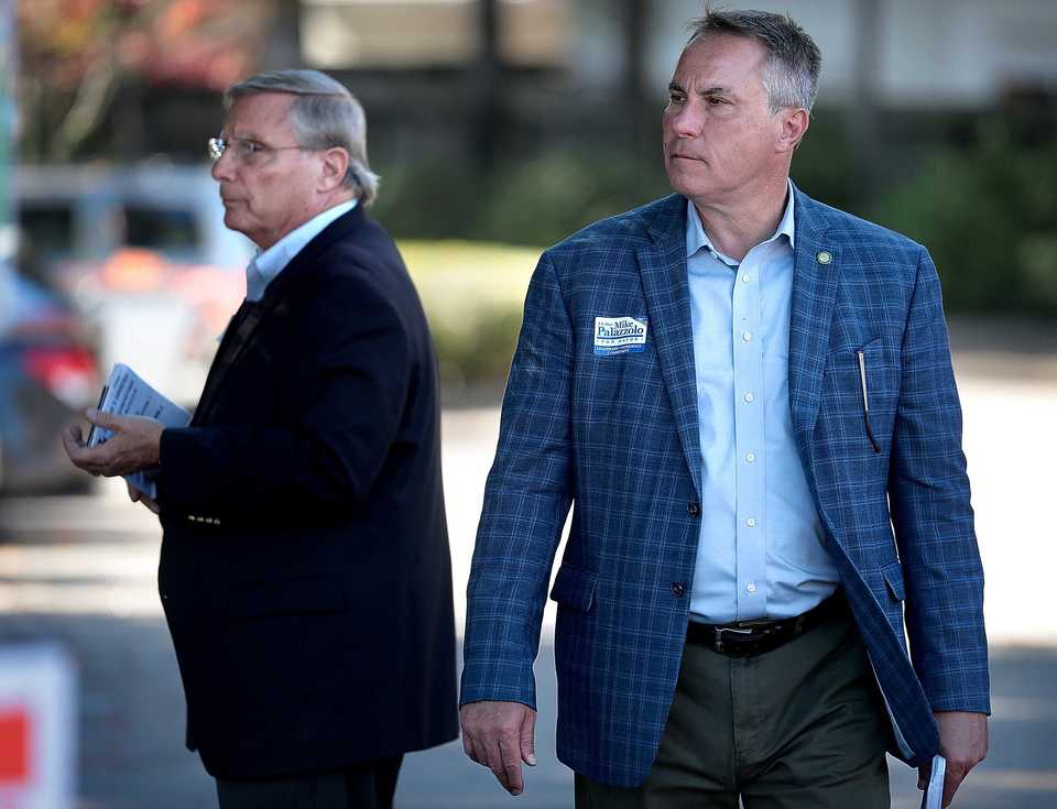 <strong>Germantown Mayor Mike Palazzolo (right) and mayoral candidate John Barzizza campaign at the Riveroaks Reformed Presbyterian Church polling location in Germantown on Nov. 6.</strong> (Jim Weber/Daily Memphian)