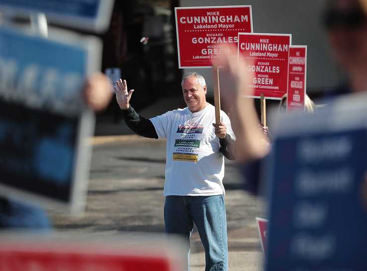 <strong>Lakeland mayoral candidate Mike Cunningham waves at voters as they enter the First Baptist Church polling location in Lakeland on Nov. 6, 2018.</strong> (Jim Weber/Daily Memphian)