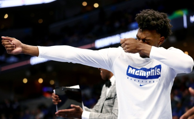 <strong>University of Memphis center James Wiseman fires an imaginary bow and arrow to pay homage to his teammate's marksmanship from deep during a blowout win against Alcorn State University at FedExForum on Nov. 16, 2019. (Patrick Lantrip/Daily Memphian)</strong>
